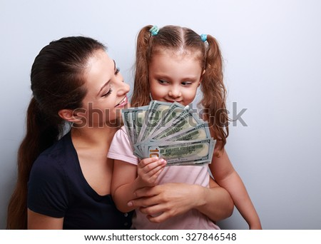 Happy casual family holding dollars and thinking how to spend the money. Portrait - stock photo