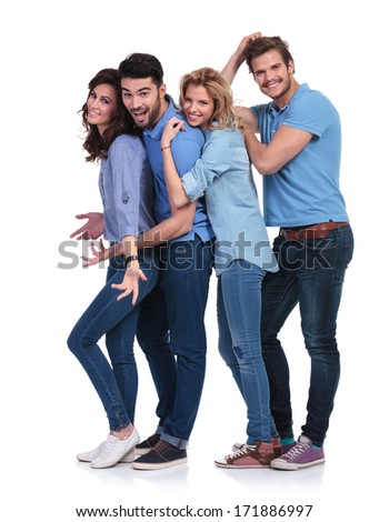 happy casual group of young people having fun together on white background