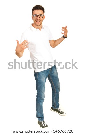 Happy casual man in white shirt and jeans gesturing isolated on white background