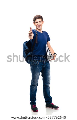 Happy casual man with folders and backpack showing thumb up isolated on a white background - stock photo