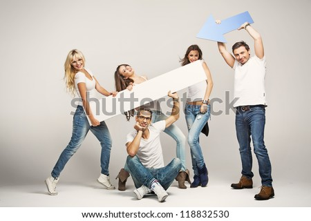 Happy casual people with white empty board