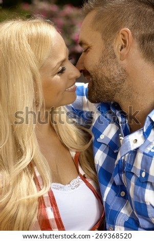 Happy casual romantic couple kissing. Attractive blonde caucasian woman and handsome stubbly man. - stock photo