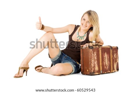 Happy casual woman leaning on an old suitcase  hitchhiking, isolated on white - stock photo