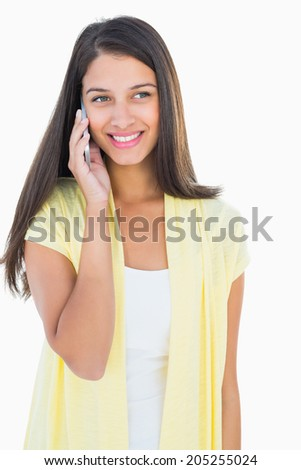 Happy casual woman on the phone on white background - stock photo