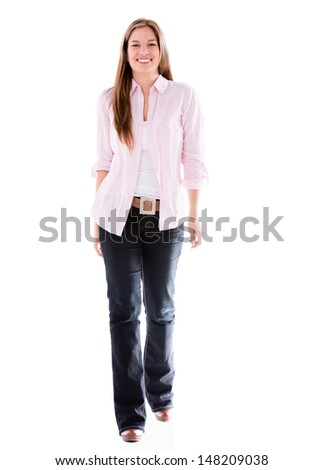 Happy casual woman walking - isolated a white background  - stock photo