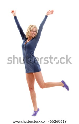 Happy casual woman with arms up isolated over a white background