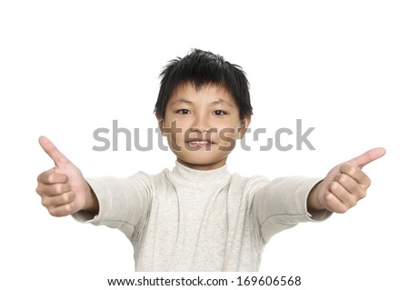 Happy casual young little boy man showing thumb up - stock photo