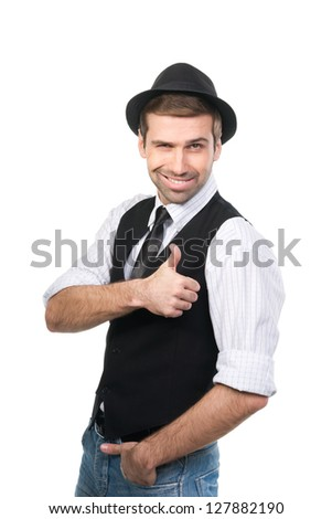 Happy casual young man in hat showing thumb up and smiling. Isolated on white background - stock photo