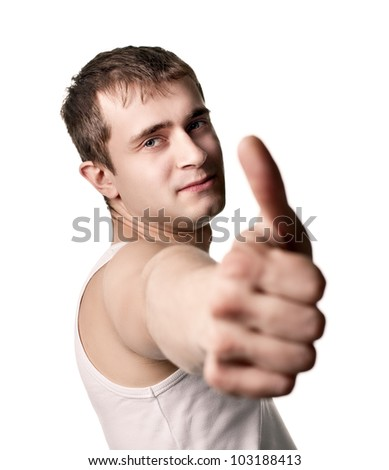 Happy casual young man showing thumb up isolated on white background