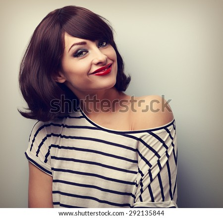 Happy casual young smiling woman with short hairstyle looking. Vintage closeup portrait - stock photo