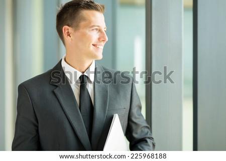 happy caucasian businessman in modern office - stock photo