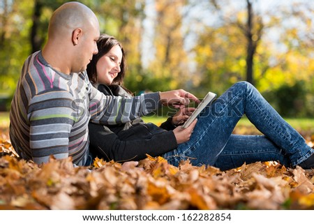 Happy Caucasian Couple With A Digital Tablet