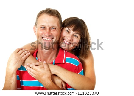Happy caucasian family having fun and smiling over white. Wife hugs her husband - stock photo