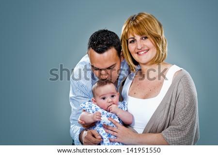 Happy Caucasian Family in the Studio - stock photo