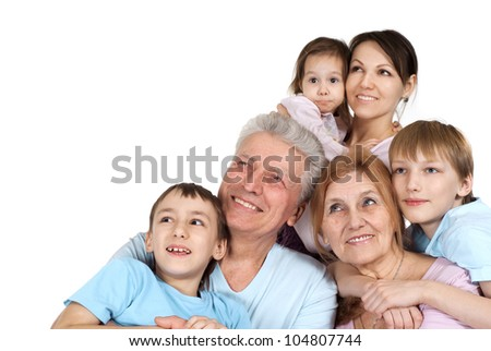 Happy Caucasian family of six on a white background - stock photo
