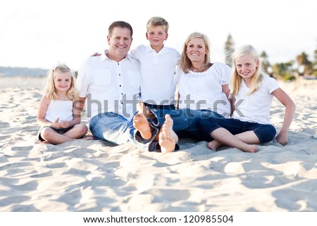Happy Caucasian Family Portrait at the Beach One Sunny Afternoon. - stock photo