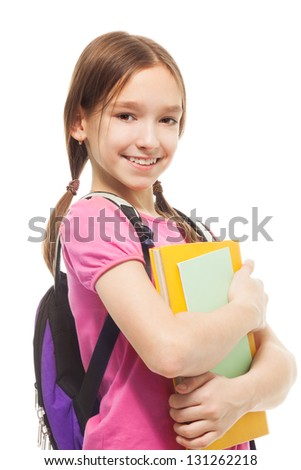 Happy Caucasian girl with books and beautiful ponytails standing holding pile of books and smiling, isolated on white