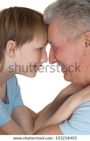 Happy Caucasian grandfather and grandson on a white background