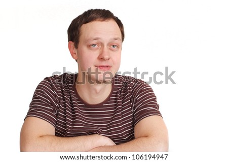 Happy caucasian man posing on a white background