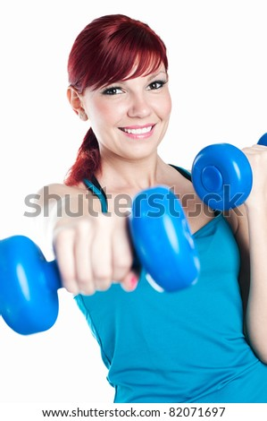 Happy caucasian woman exercising with dumbbells, isolated on white