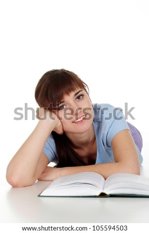 Happy Caucasian woman lying with a book on a white background