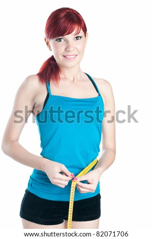 Happy caucasian young woman measuring her waist with a centimeter, isolated on white - stock photo
