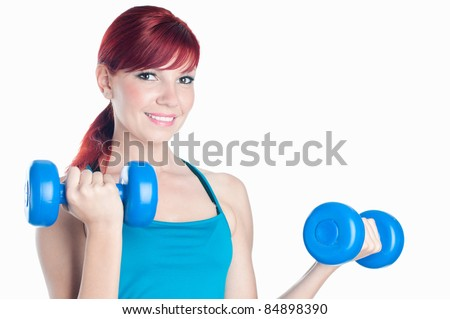 Happy caucasian young woman with dumbbells, isolated on white background - stock photo