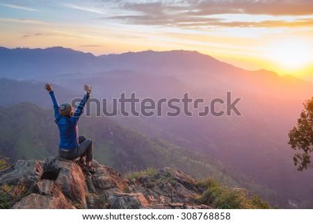 Happy celebrating winning success woman - stock photo