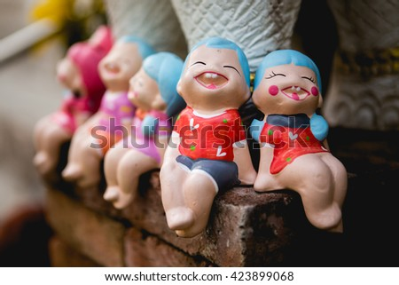 Happy Ceramic dolls for garden decoration.