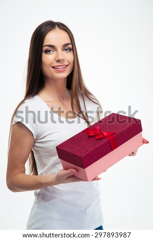 Happy charming woman holding gift box isolated on a white background