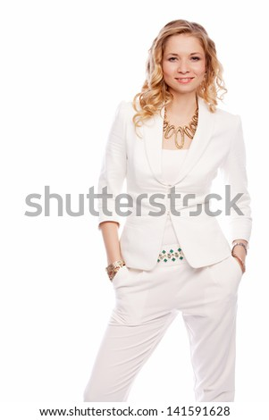 happy cheerful business woman stands in white suit isolated on white background - stock photo