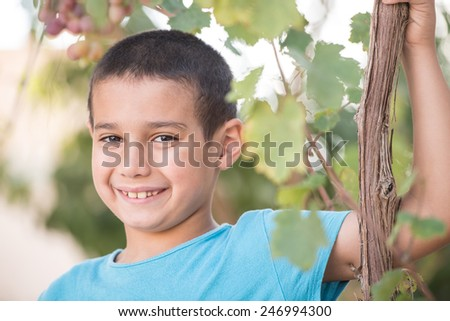 Happy cheerful child in nature - stock photo
