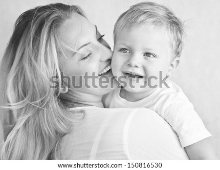Happy cheerful family. Mother and baby having fun - stock photo