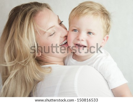 Happy cheerful family. Mother and baby having fun