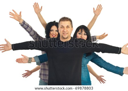 Happy cheerful friends standing with  hands up behind a mid adult man isolated on white background
