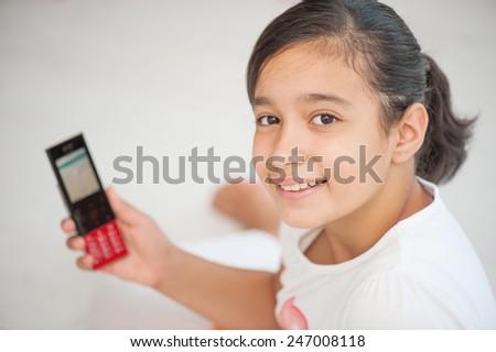 Happy cheerful little girl - stock photo