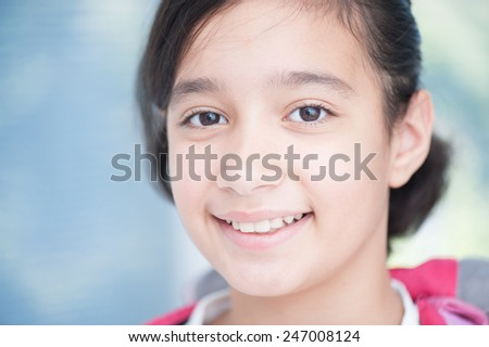 Happy cheerful little girl - stock photo