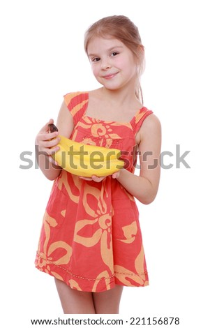 Happy cheerful little girl holding yellow bananas/Happy girl holds a bunch of bananas, isolated on white - stock photo