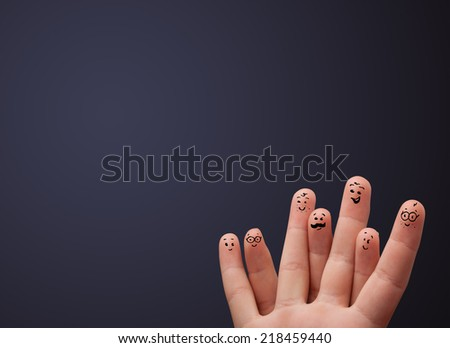 Happy cheerful smiley fingers looking at empty wall copyspace