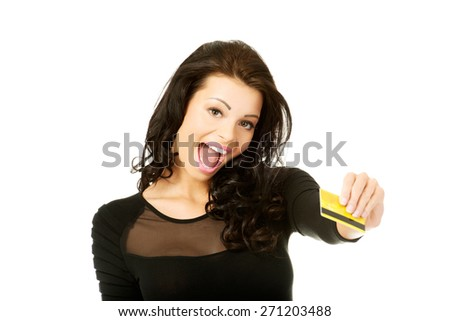 Happy cheerful woman holding credit card. - stock photo