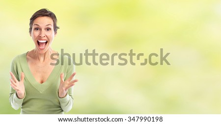 Happy cheerful young woman over green background. - stock photo