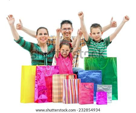 Happy cheering family in white room - stock photo