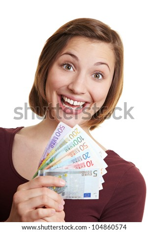 Happy cheering woman holding Euro money fan in her hand - stock photo