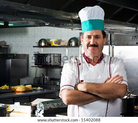Happy chef at work - stock photo