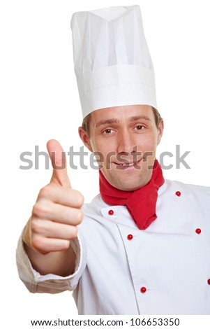 Happy chef cook holding his thumbs up - stock photo