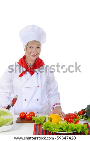 Happy Chef uniforms in preparing a healthy salad. Isolated on white background