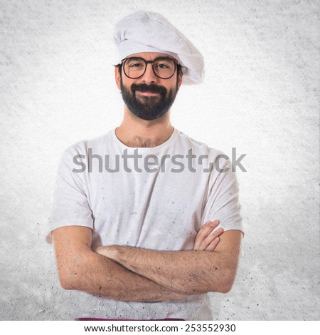 Happy chef with his arms crossed