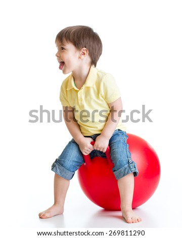 Happy child boy jumping on bouncing ball. Isolated on white. - stock photo