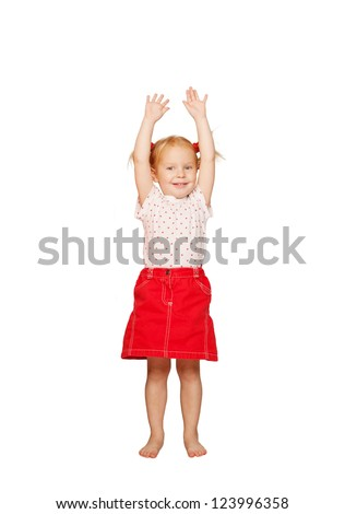 Happy child doing exercises, lifting up her hands. Isolated on white background - stock photo