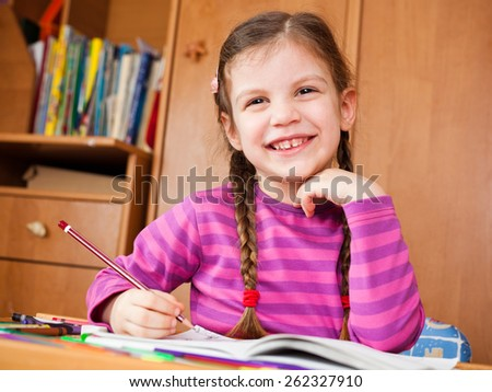 Happy child drawing